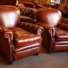 Buttoned Arm Antique Leather Club Chairs