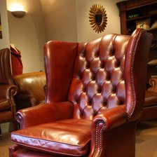 The High Back Georgian Leather Wing Chair with Claw & Ball Legs