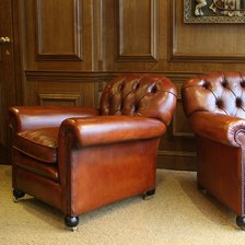 Buttoned Back Antique Pair of Leather Club Chairs