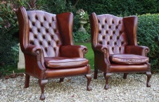 Pair of Vintage Tall Claw & Ball Georgian Leather Wing Chairs