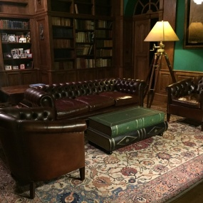 A Leather Chesterfield & A Pair of Buttoned Back Amsterdam Chairs